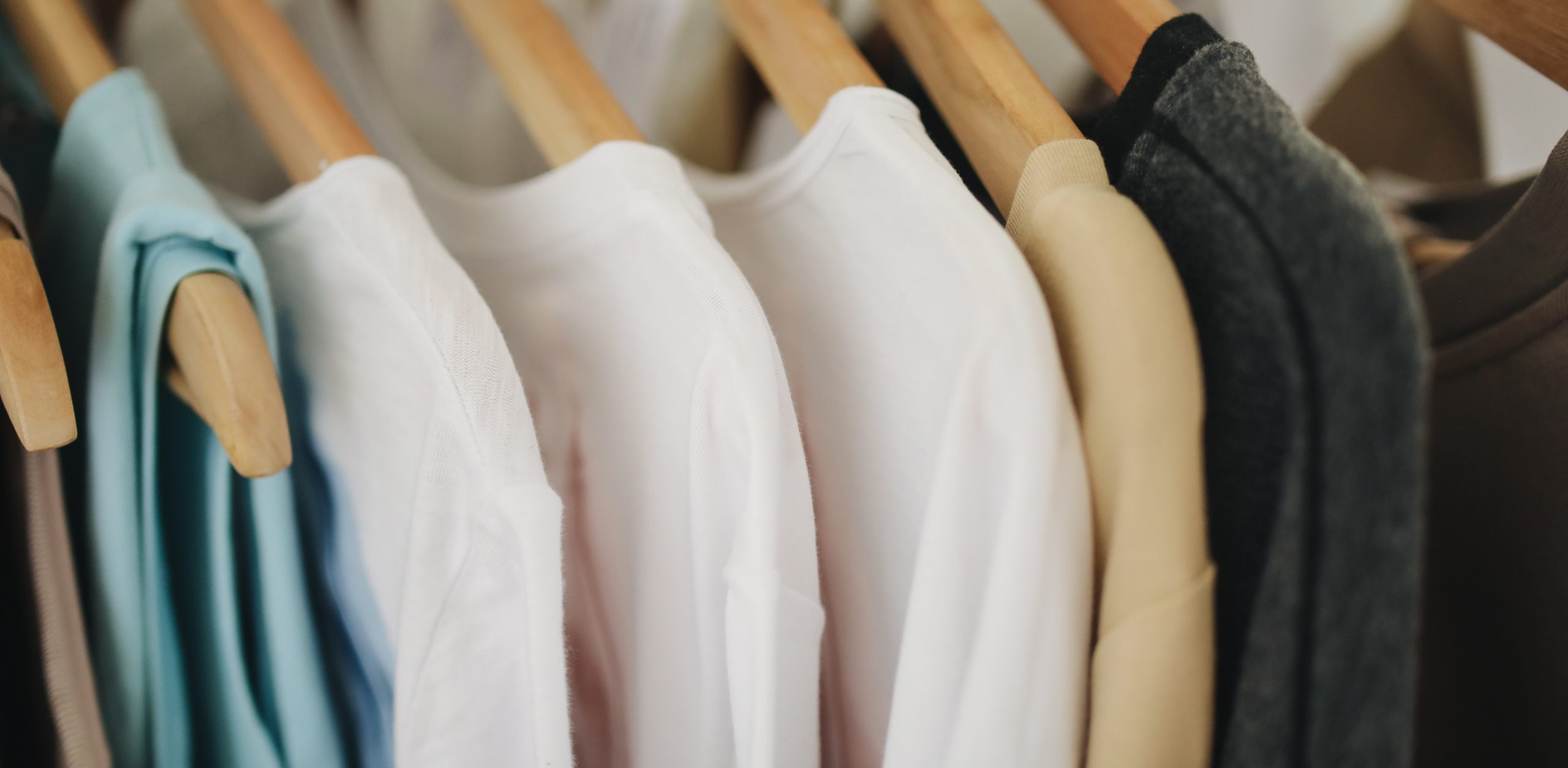 white-long-sleeves-shirts-on-brown-wooden-clothes-hanger